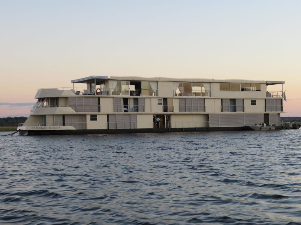The Zambezi Queen is a luxury riverboat on the Chobe River. See the wildlife along the river on excursions and from your stateroom.
